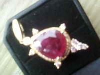 ONE IS A RUBY 8 1/4 CARAT WITH A 1/2 CARST DIAMOND