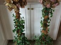2 topiary fake rose plans with rich fake ivy leaves at