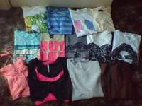 there are 13 tops in this lot all are sizes med-lrg
