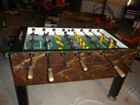 For sale is a used coin-op tornado foosball table.