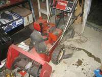 Toro 2 stage snow blower, with tire chains, runs ok