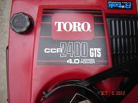 This is A used TORO CCR 2400 has the 4hp R-TEK Motor