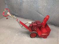 This is a vintage snow thrower from 1967. Runs good