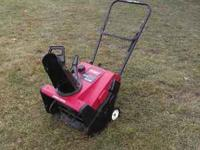a nice toro snowthrower starts in 2 pulls very easy to