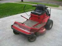for sale is a commercial lawn mower - wheel horse, its