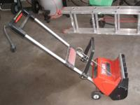 For sale is an electric Toro snowblower model S-120.