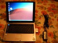 Good running laptop with charger, battery is in good