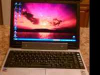 I AM SELLING MY TOSHIBA THAT HAS 1.5GB RAM, 100GB HARD