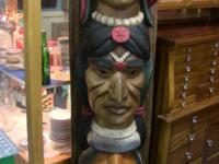 Beautiful carved and painted totem pole. Stands 70""