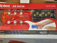Totes Air Guitar $10.00.  885 N United States Freeway