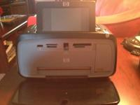 Hp Photosmart printer in wonderful condition. Has power