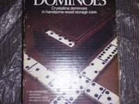 This ad is for Tournament Dominoes in handsome storage