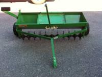 John Deere tow behind rear aerator with spreader