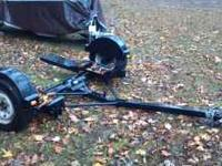 Tow dolly for car is in like new condition. Nothing at