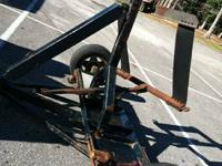 Tow dolly made use of for hauling trucks and