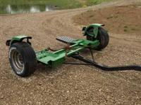 This is a used Demco tow dolly. It is very heavy duty