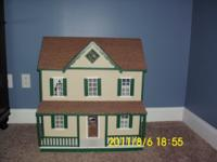 Seven-room, hand-painted dollhouse includes: living