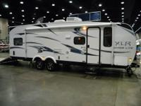 This is a half ton towable toy hauler camper. Queen bed