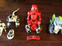 I have 3 robot toys. The red guy has his remote and he