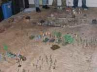 Plastic tub full of toy soldiers, tanks, buildings,