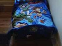 THIS TOY STORY 3 BED COMES WITH A NEW MATTRESS AND