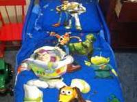 Toy Story toddler bed with the matching bedding set and