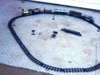 Toy train, runs on battery, has lots of track, the