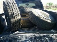 4 Toyo Open Country tires with the wheels for sale. The