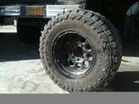 Set of 4, 35/12.5/17 Toyo Muds with 50% tread on black