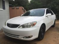 "Good condition, A/C, leather seats, 18""rims, automatic."