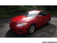 Toyota Camry LE 2011 with 63k miles, has sunroof, side