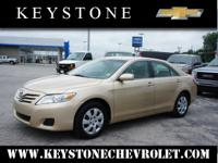 Say hello to your new vehicle, this tan 2010 Toyota