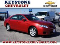This red 2011 Toyota Camry LE is a keeper. We give you