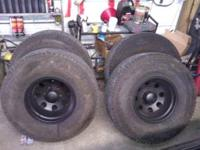 A/t wheels and tires 90% thread left. Wheels have been