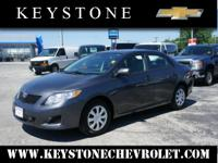 Set your sights on this gray 2010 Toyota Corolla LE. It