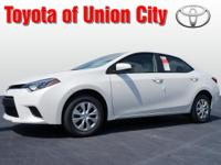 This white 2014 Toyota Corolla LE Eco might be just the