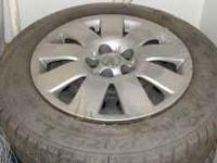 Set of 4 rims and tires off of a 2003 Toyota Corolla.