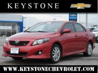This red 2010 Toyota Corolla S might be just the sedan