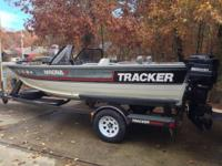 1988 Tracker Magna 17 foot WT boat with roller trailer.
