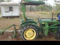 ITS A JOHN DEER TRACTOR THAT NEEDS A LITTLE MINER WORK