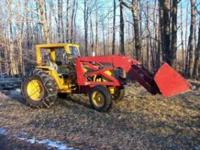 Tractor: International 1200A industrial: $5900.