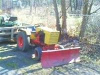 Case 444 with plow and mower deck. It is hydrostatic.