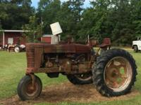 1948 M farmall tractor . Needs restoring. Engine and