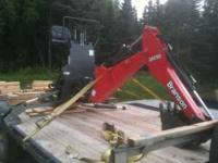 The backhoe is new, and unused, but has been stored for