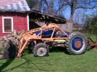 9N Ford Tractor with backblade and front loader.