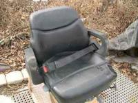 Heavy duty seat for tractor or skid steer, storage bin