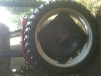 NICE SET OF TIRES AND RIMS,70% RUBBER. O.NLY USED FOR