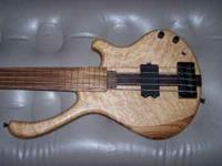I have a custom made fretless 5 string bass that I
