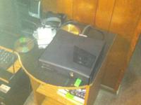 I have an Xbox 360 Slim, barely been played. Used for