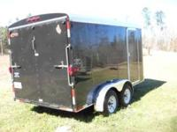 THE BLACK 7' X 14' ENCLOSED TRAILER IS A 2010 MODEL